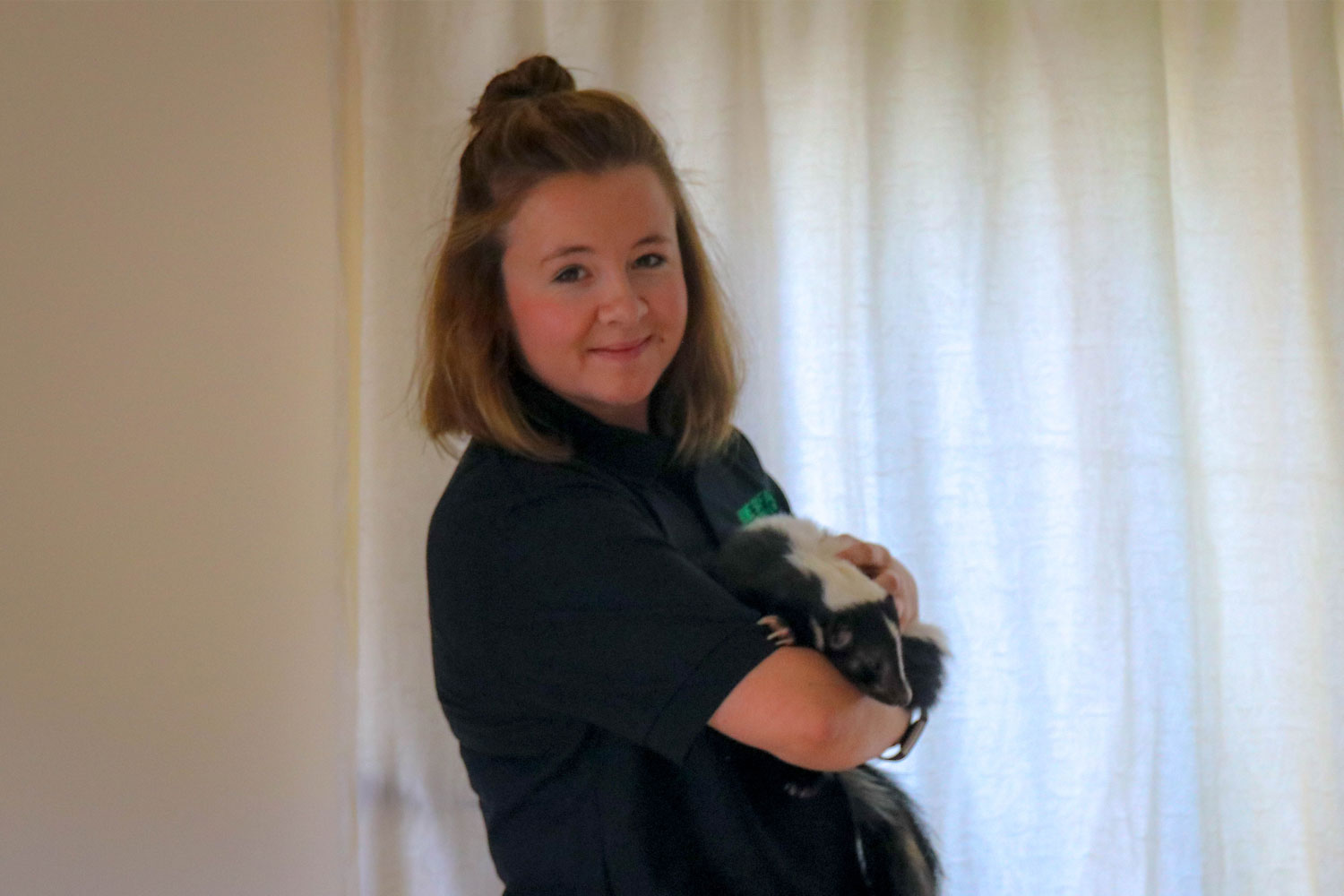 Amanda holding one of our skunks